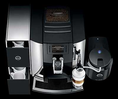 An image of Jura E8 Automatic Coffee Center's boiler, telescoping coffee spigot, brew unit and control panel