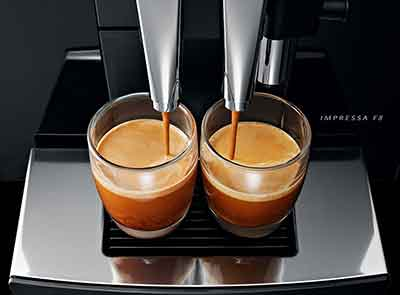 Two cups of espresso produced by the Jura Capresso F8