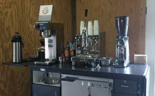 An image of the QuickMill Achille and a coffee grinder