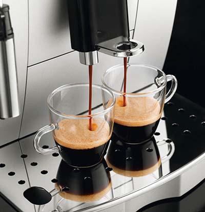 "An image of DeLonghi ECAM22110SB's coffee spigots, which can accommodate cups up to 5.5"" in height"