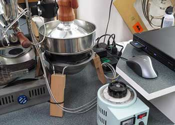 An image of Huky 500 Coffee Roaster connected to a laptop