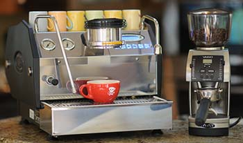 An image of the Baratza Vario with an espresso machine